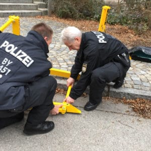 Police officers installing MVB