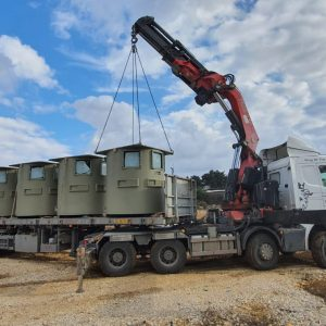bullet resistant booths unloaded from a truck