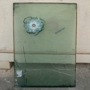 Fortified Windows, a Security Product by Mifram: Bullet proof window after a direct hit. The window saved the lives of soldiers of a UN International Peace Keeping force