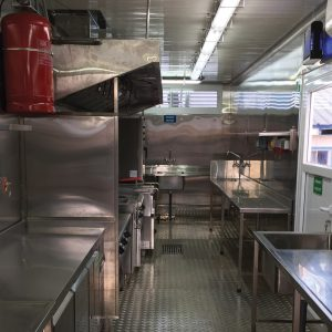 Mobile Kitchens, an Auxiliary Building by Mifram: Use of 40-foot containers provides a large and comfortable working area
