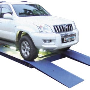 UVIS, a Security Product by Mifram: The vehicle to be checked drives onto a, low ramp and a camera system checks the vehicles chassis